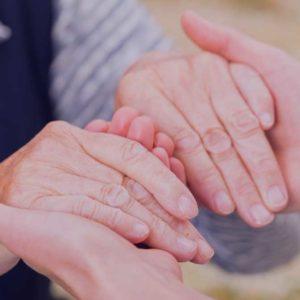 Doctors Helping Hands holding patient hands